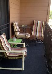 Partial view of 25' Balcony. Additional 3 chairs and table not shown. - Myrtle Beach Resort condo vacation rental photo