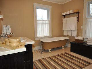 Lenox house photo - Bath features clawfoot tub, tiled walk-in shower & laundry