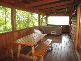 Gatlinburg cabin photo - Picnic table and hot tub on the screened deck.