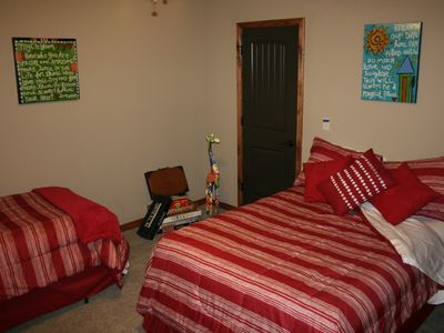 Kids room with twin and full sized beds.