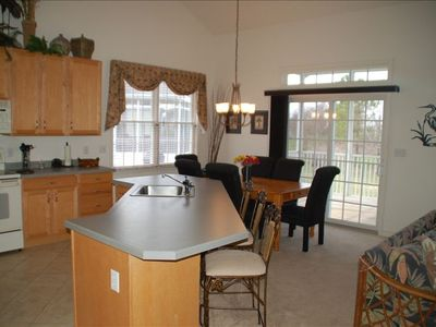 KIthchen, Breakfast Bar and exit to Screened Porch, Sun Deck and Grill Area.