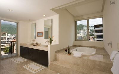 Fabulous bathroom with jacuzzi tub off the first master bedroom