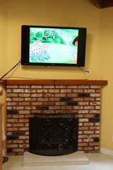 "Huntington Beach house photo - Cozy fireplace with 55"" television"
