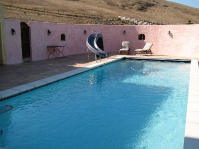 Take a Dip in the Heated Pool, or relax with a glass of wine on the verranda