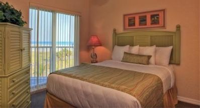 Master bedroom with balcony overlooking the beach