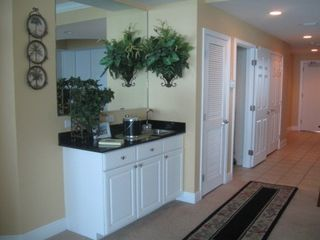 Gulf Shores condo photo - Entrance hallway and wet bar next to living room.