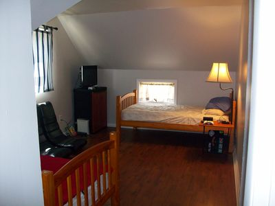 One of 3 bedrooms. Arrangement of furniture may be different now
