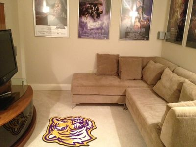 Media Room 5 with 2 couches and star wars movie series posters