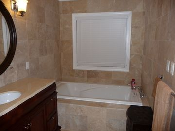 master bathroom with bathtub and shower