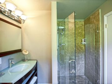 Large, walk in master shower. Double Italian glass sinks.