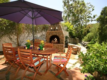 Montecito cottage rental - Creekside patio and outdoor fireplace