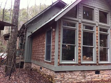 Ellijay cabin rental - Cabin is situated in curve of Rock Creek providing a view from every window.