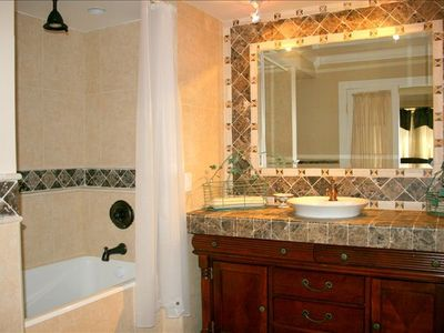 Bathroom w/ tub in third master suite that has one King and one twin size bed