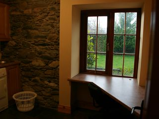 Killarney cottage photo - The large laundry room with a desk