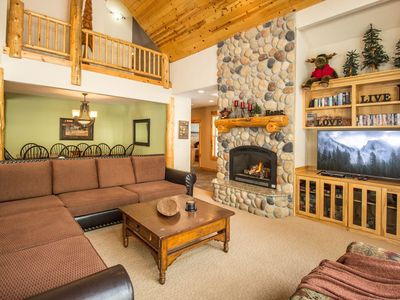 "Great Room / Beautiful River Rock Fireplace / 60"" HDTV"
