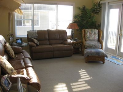 Comfortable living room with reclining loveseat. sofa, chair, 50 inch HDTV