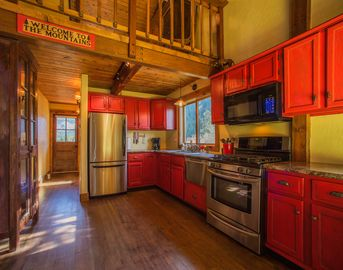 Blue River cabin rental - The powder pad's kitchen, featuring stainless steel appliances