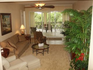 Naples townhome photo - Living room opens to large lanai overlooking small pond