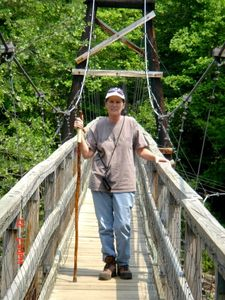 Lynn on longest swinging bridge west of the Mississippi
