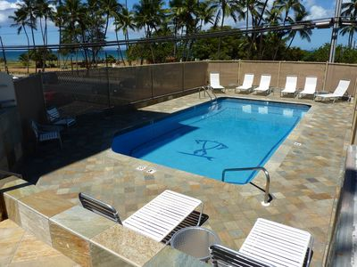 Pristine pool steps away from the condo and ocean views.