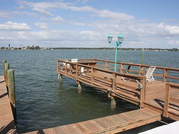 Treasure Island condo rental - View from the deck of the pool-boat docks and fishing docks!