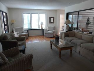Harbour Town house photo - Large living room with plenty of comfortable seating, overlooks pool and lagoon