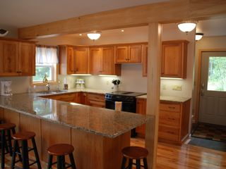 New Kitchen with seating for 6. Kitchen has view of shipping channel, Goose Bay - Alexandria Bay cottage vacation rental photo