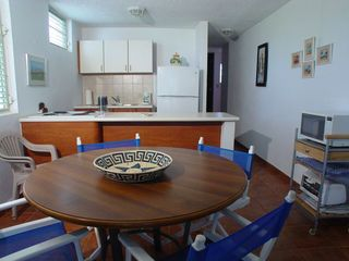 Cabo Rojo apartment photo - Kitchen view from dining area. Microwave and toaster oven on right hand cart.