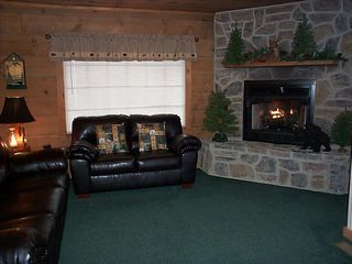 Great room with large picture window viewing mountains. - Pigeon Forge cabin vacation rental photo
