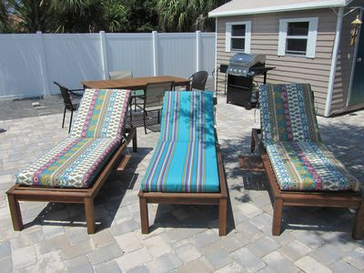3 Lounge chairs with the outdoor table and grill behind
