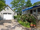 garage, house and deck with retractable awning - South Jamesport cottage vacation rental photo