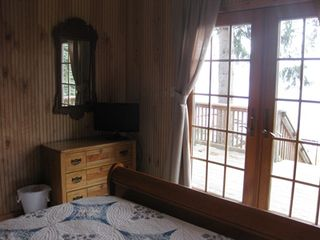 New Milford cottage photo - Another view of master bedroom with access to deck and lake view