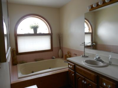 Master bath has jacuzzi tub and stand up shower ....roomy and bright.....