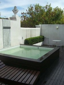 Palermo apartment rental - Terrace with dipping pool. Water cascades into pool from marble wall panel