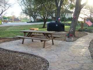 Kingsland house photo - New 90 ft stained/stamped concrete sidewalk and new combo gas/charcoal grill!