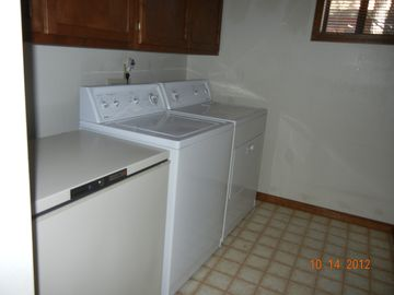 Laundry room with freezer
