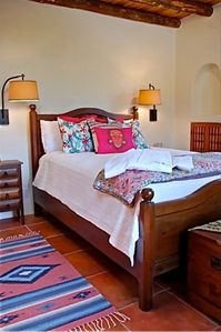 Bedroom 2 with queen-size bed and Kiva fireplace.  Bath with tub, mtn view