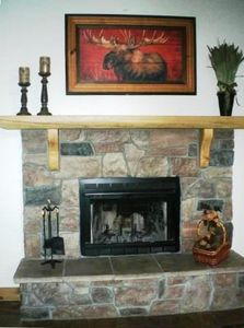 This beautiful stone fireplace adds to the ambiance of the Great Room.