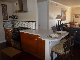 San Clemente condo photo - Quartz counter top and seating at bar for two