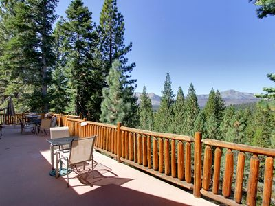 Log railings surrounds this large deck with views.