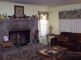 Pigeon Forge chalet photo - Relax in the Den area with Beautiful Stone Fireplace
