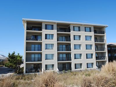 cozy, comfortable 2 bedroom oceanfront condo with coastal decor, free wiFi, and gorgeous view of the ocean and dunes just steps to the beach!