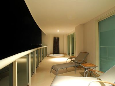 Direct Beachfront Terrace with Lighting and lounges throughout. Evening Views