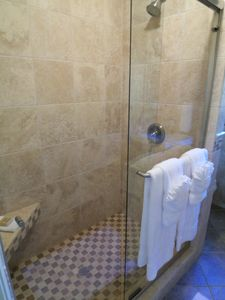 Travertine tiled bathroom