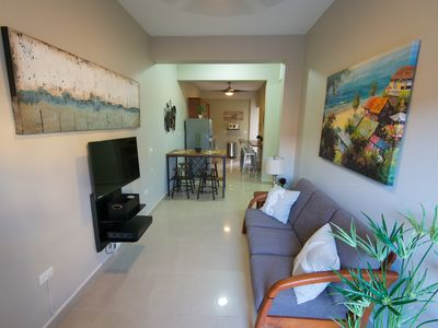 NEW LISTING! Walk to Restaurants, beach, pubs, bars...from new 2 bdr apartment.
