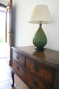 Vintage 18th century cabinet drawers with lamp in entrance hall