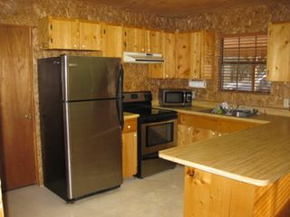 Concan cabin photo - Full size kitchen with stainless steel appliances