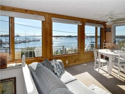Enjoy the waterfront views from the living room or outside from the deck.