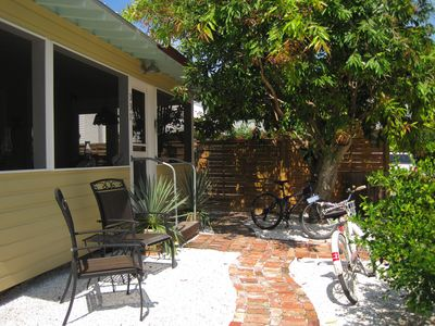 Boca Grande house rental - Welcome to Whitewash Alley! Here's the front door to the big screened porch.