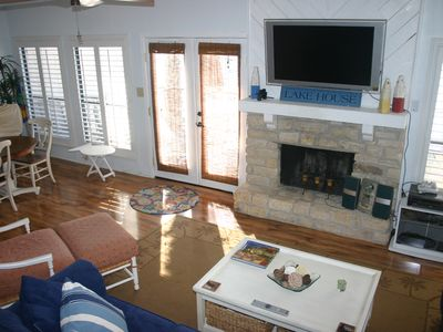Main floor features wall of windows and walk out to the deck facing the lake.
